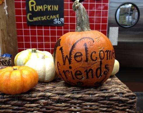 A pumpkin welcome sign