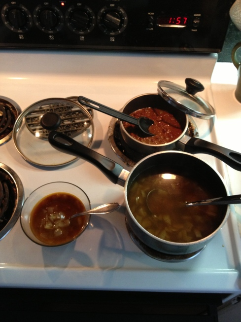 onion soup and veggie chili on the stove
