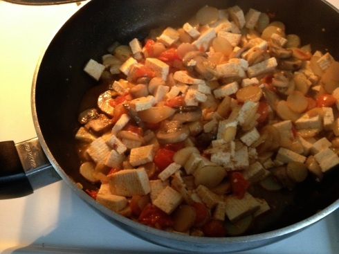 Trader Joe's mini taters scramble up well with tofu, tomatoes, garlic and mushrooms