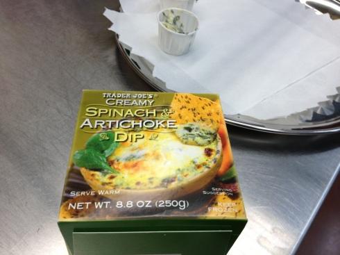 Sampling Trader Joe's spinach artichoke dip at the tasting bar