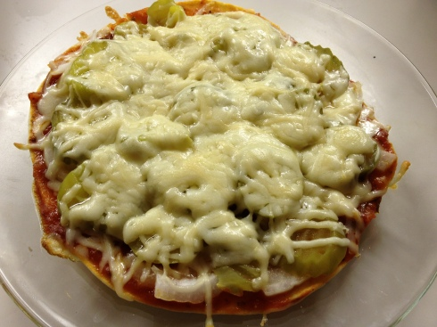 Top a tortilla with tomato sauce, onion, pickles and cheese, and you've got a pizza